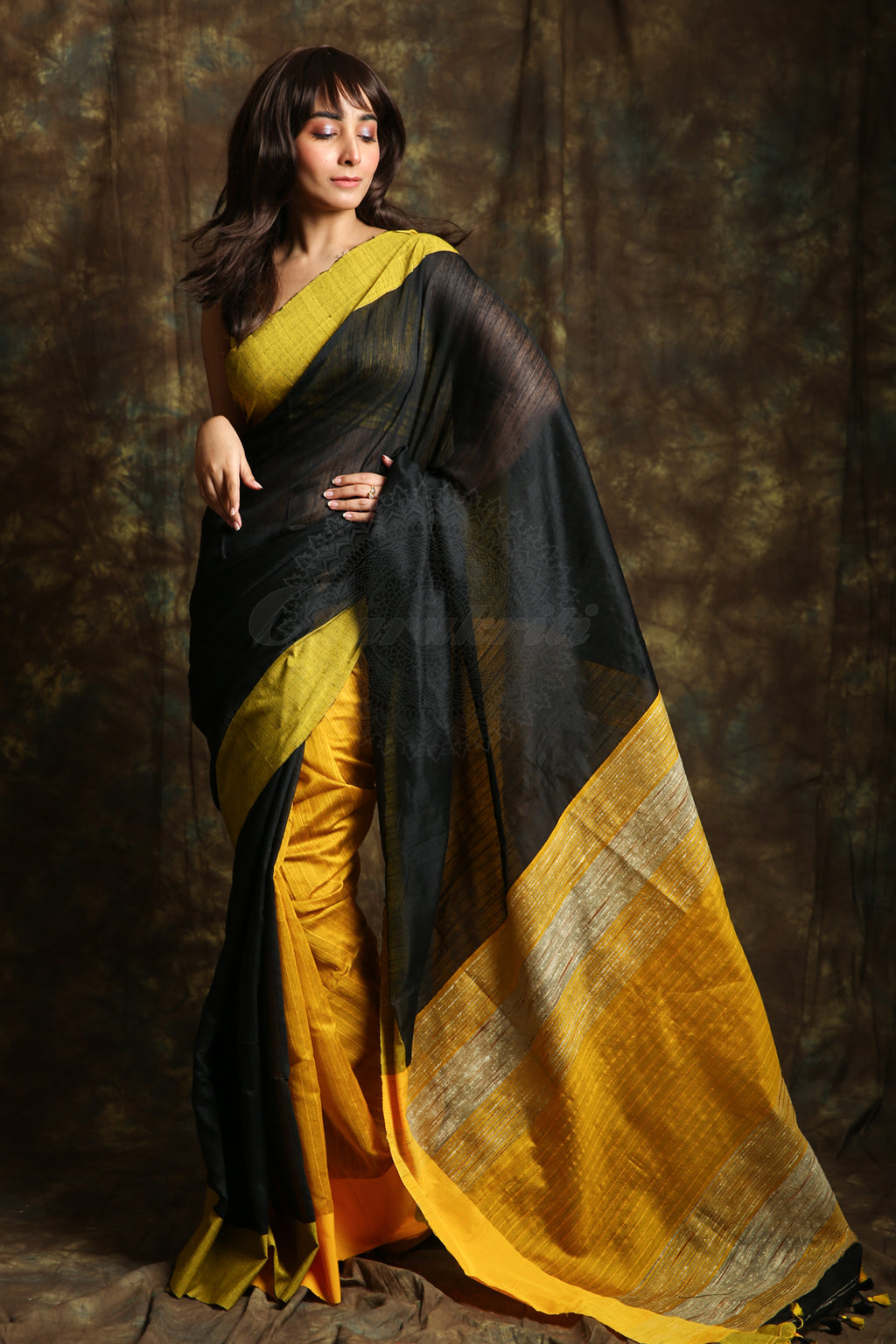 The blended cotton based black & yellow color saree have all over stripes body. The pallu have yellow color gheecha stripes work and yellow border. - Charukriti.co.in
