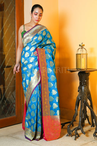 SKY BLUE BANARASI SAREE WITH ALL OVER ZARI WORK AND PINK PALLU