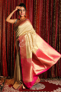 ZARI WEAVED BEIGE BANARSI WITH SMALL BUTA AND PINK PALLU