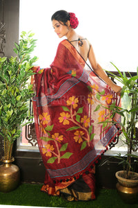 MAROON PURE LINEN SAREE WITH ZARI BORDER AND FLORAL WEAVED PALLU