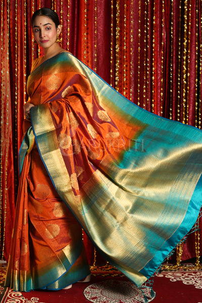 RUST DUAL TONE BLENDED SILK WITH ALLOVER ZARI WEAVING AND SKY BLUE BORDER & PALLU