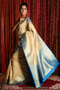 ZARI WEAVED BEIGE BANARSI WITH SMALL BUTA AND SKY BLUE  PALLU