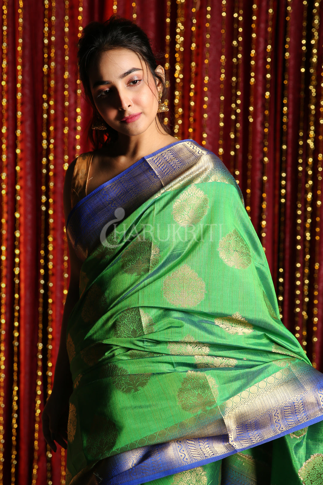 GREEN DUAL TONE BLENDED SILK WITH ALLOVER ZARI WEAVING AND BLUE BORDER & PALLU