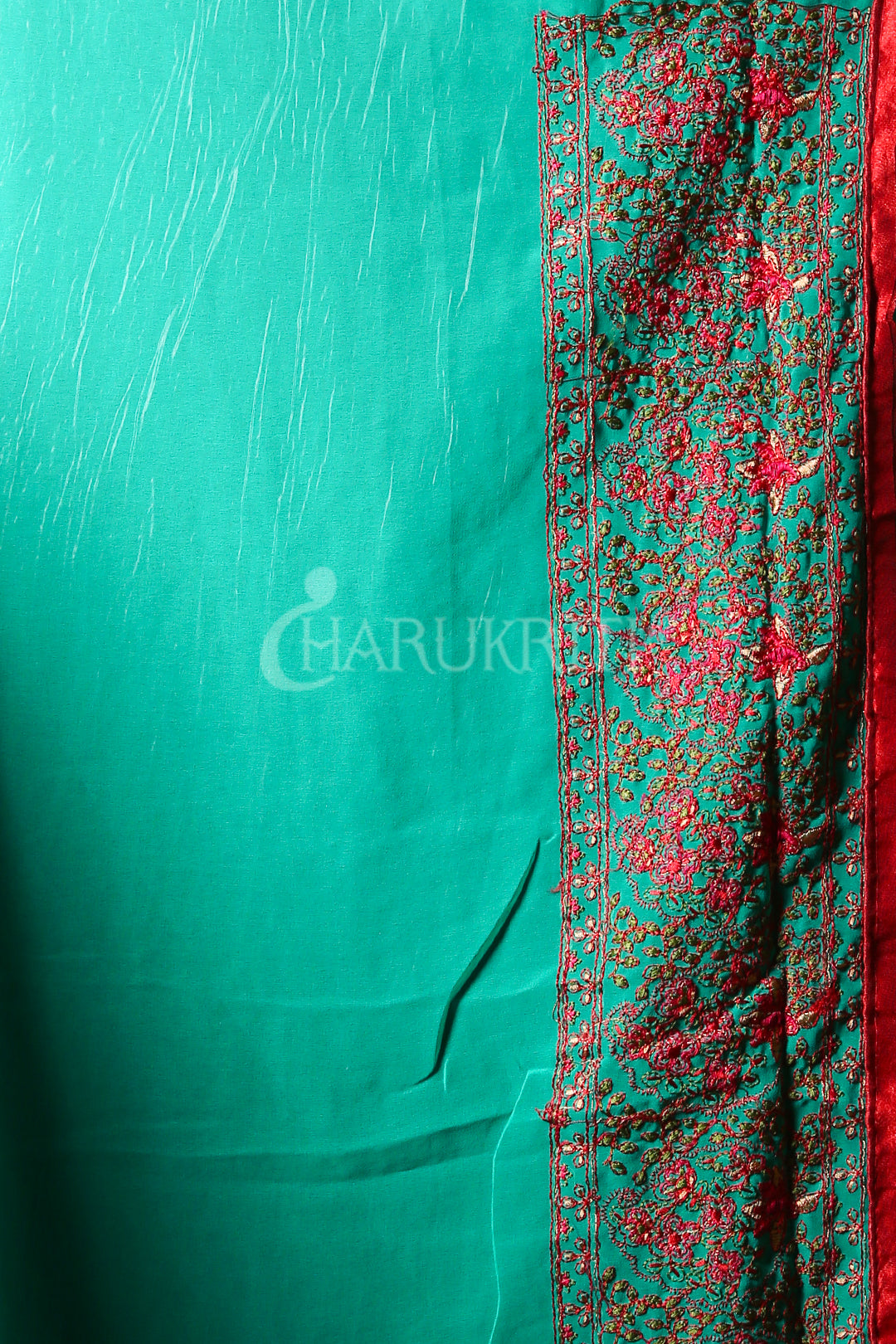 TURQUOISE BLUE CHIFFON SAREE WITH SELF EMBROIDERED AND FLORAL JARDOSI BORDER