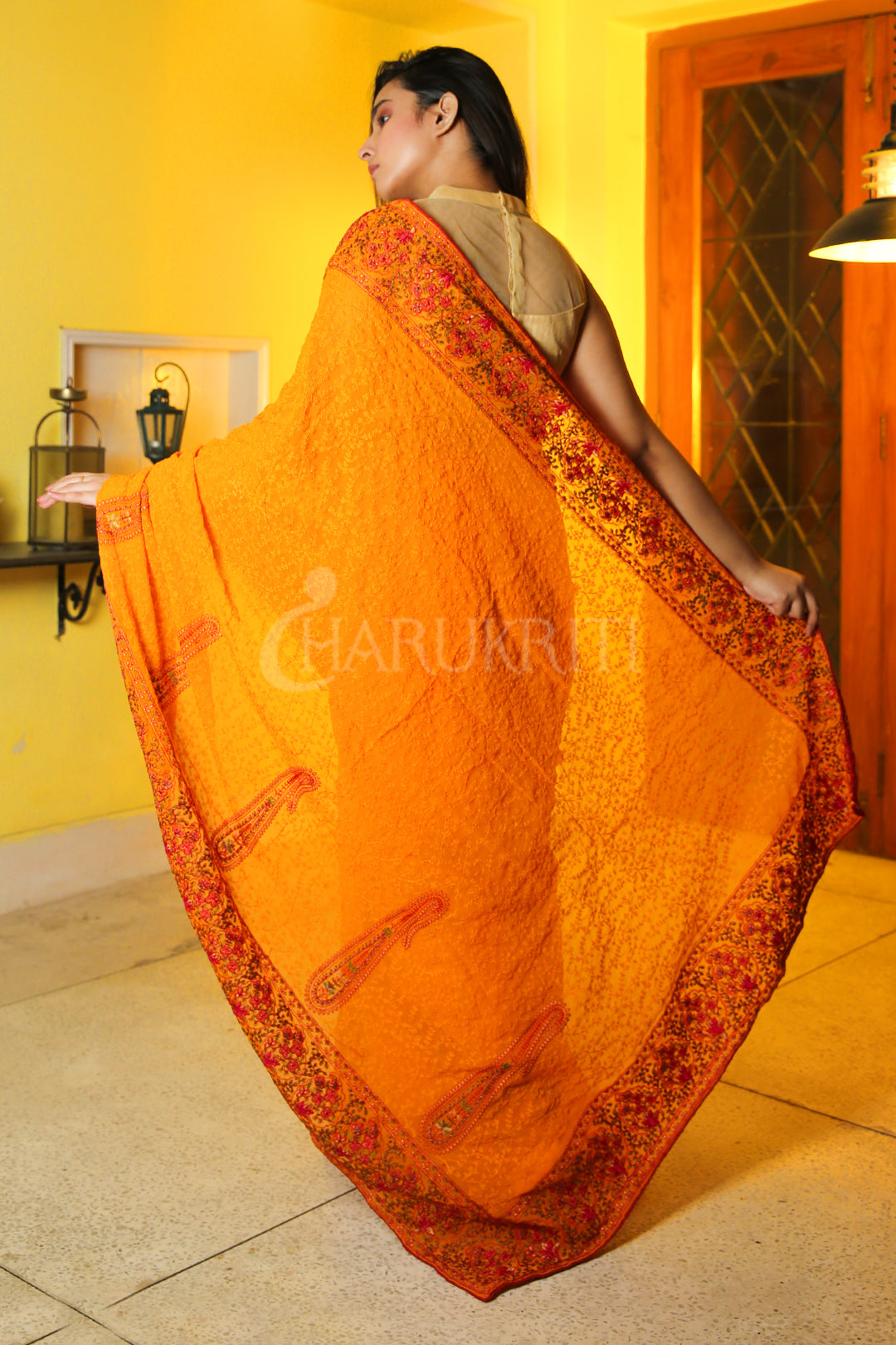 TANGERINE YELLOW CHIFFON SAREE WITH SELF EMBROIDERED AND FLORAL JARDOSI BORDER