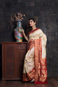 OFF WHITE  MANIPURI SILK WITH RED ZARI BORDER AND PALLU