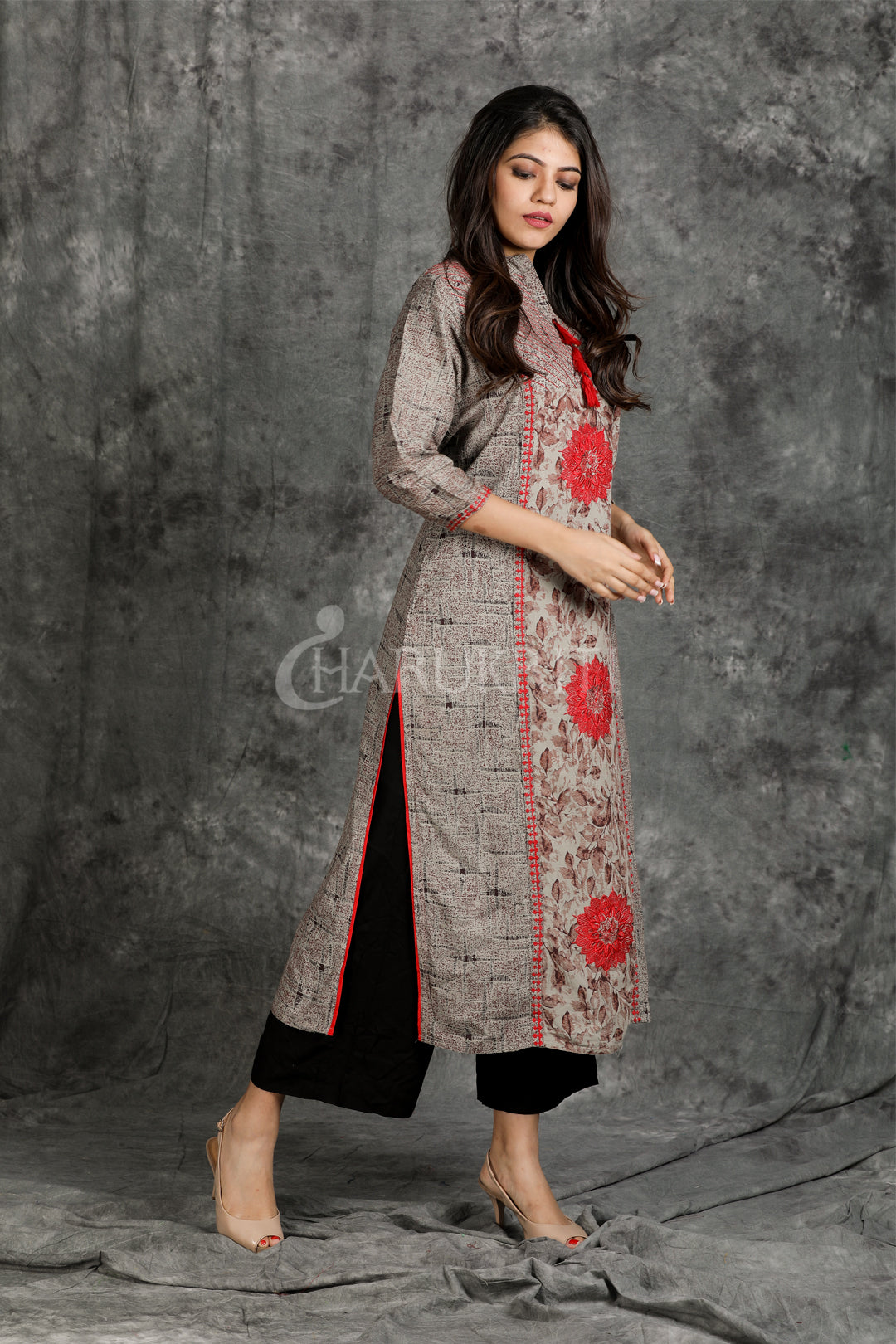 Running Stitched and Resham Embroidered Textured Kurti