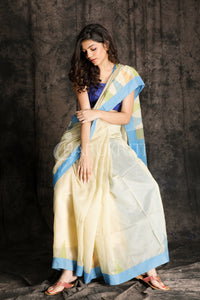 OFF WHITE  HANDLOOM SAREE WITH SKY BLUE TEMPLE BORDER