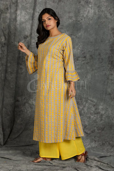 Beige cotton kurti with yellow box print and yellow palazzo - Charukriti