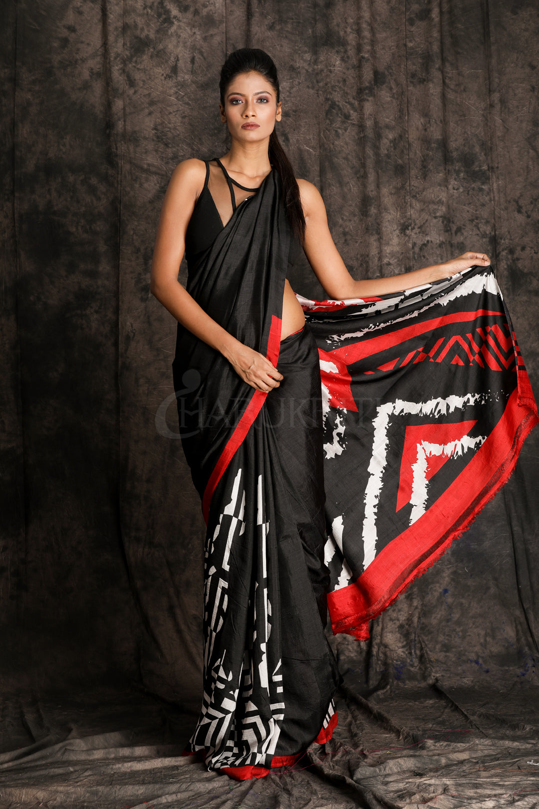 BLACK SILK WITH ABSTRACT PRINT ON PLEATS AND PALLU