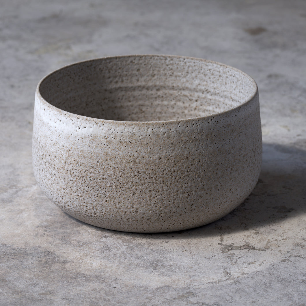 large stone bowl in rough white