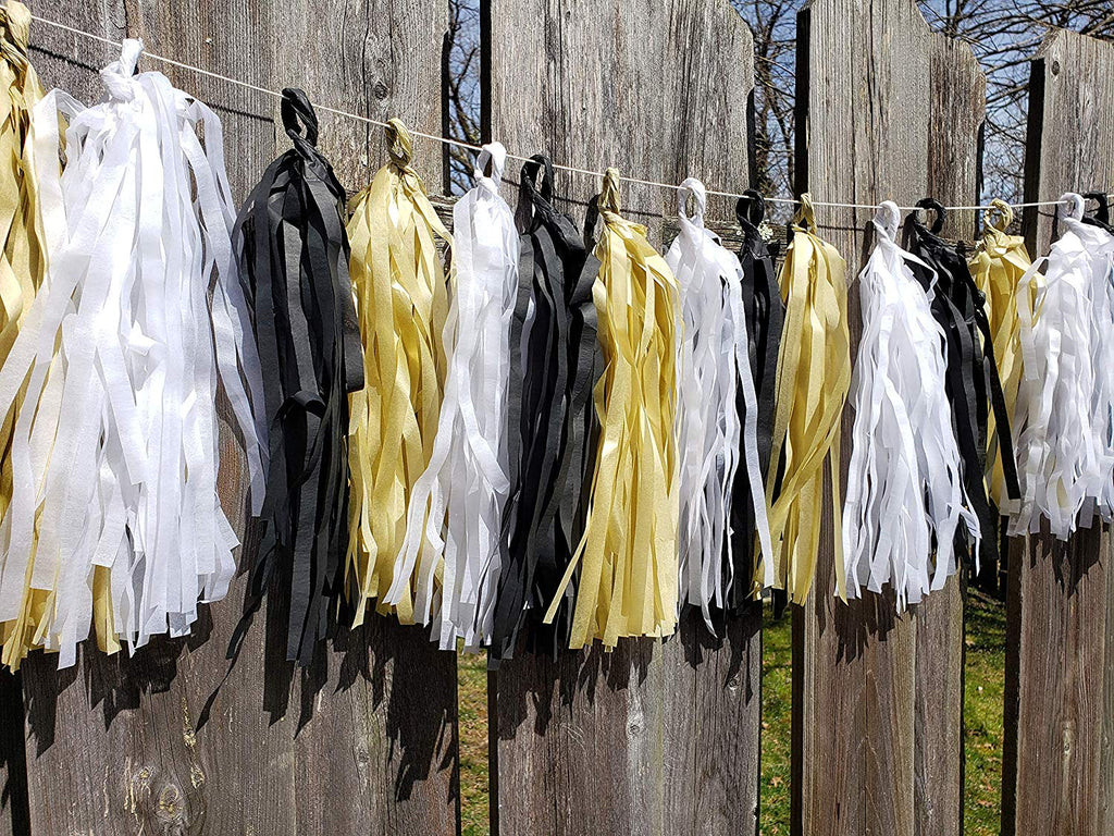gold, black and white tissue tassel banner for graduation or birthday party