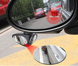Car left side mirror along with blind spot parking mirror, 2 more cars in mirror, person is sit near car tyre