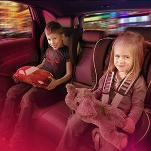 Boy and girl sit on back seat of car & atmopshere light in red colour