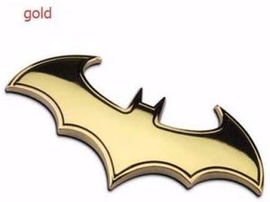batman logo in gold colour with black shade
