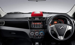 Car Dashboard with red tissue box