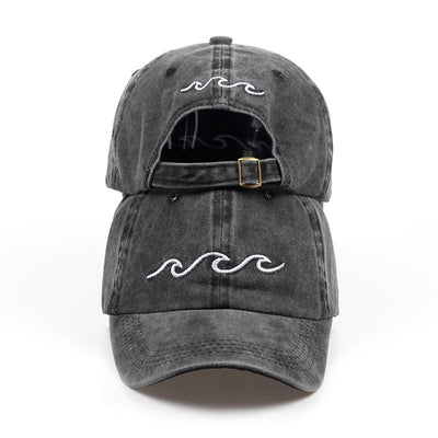 Mentawai Cap in dark grey with white waves