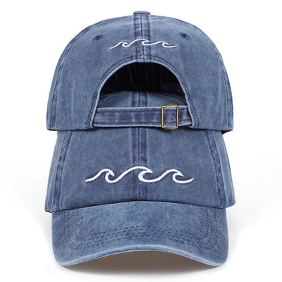 Mentawai Cap in navy blue with white waves