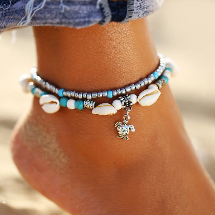 Montanita anklet with white cowrie shells and turtle charm