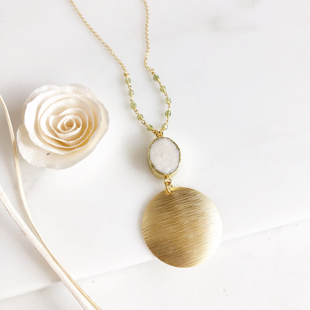 Long White Druzy and Gold Disk Pendant Necklace with Green Beading Accents in Gold.