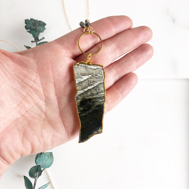 Long Black Grey and White Stone Slice Pendant Necklace with Ring and Bead Accent in Gold.