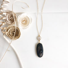Load image into Gallery viewer, Long Black and White Swirl Line Pendant and White Shell Hexagon Necklace in Gold.