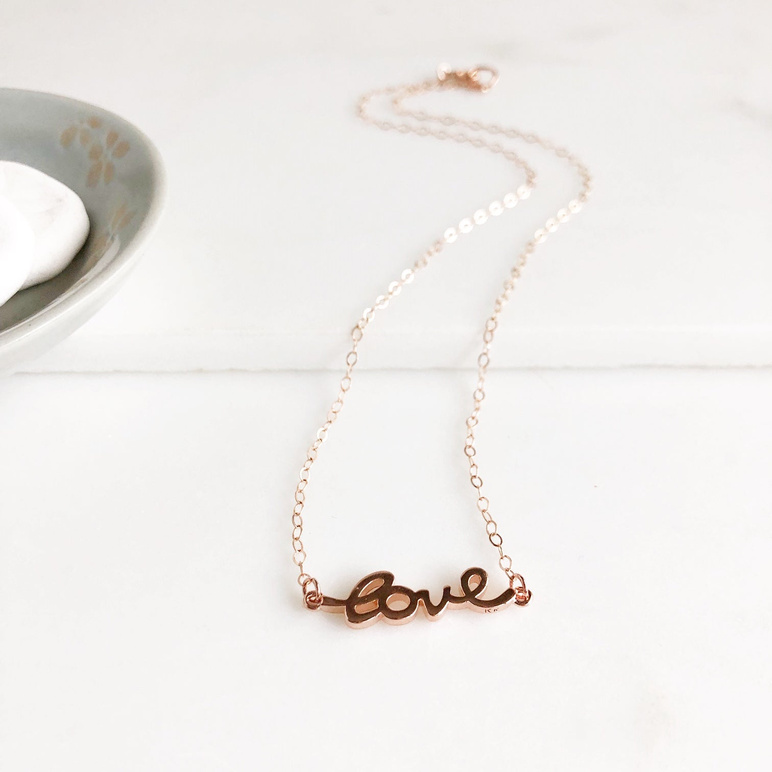 Rose Gold Cursive Love Necklace.