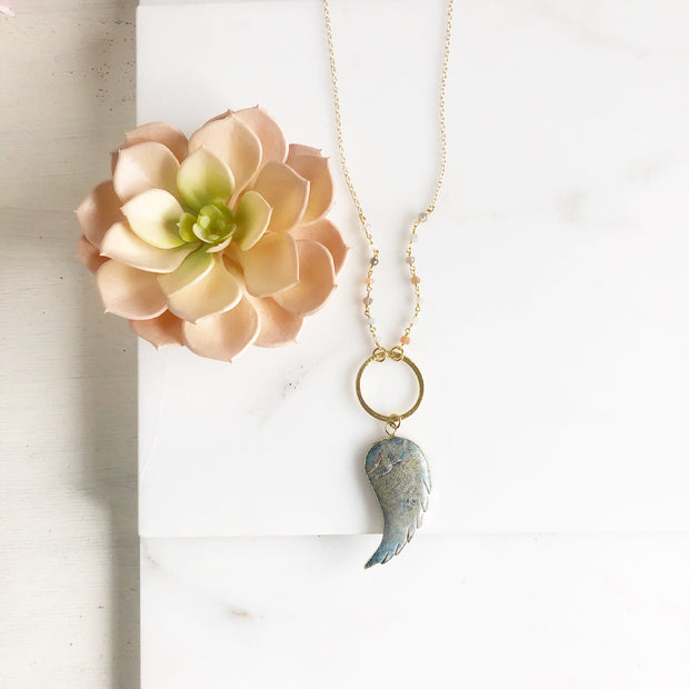 Long Wing Necklace in Shades of Blue with Textured Circle and Moonstone Beading in Gold.