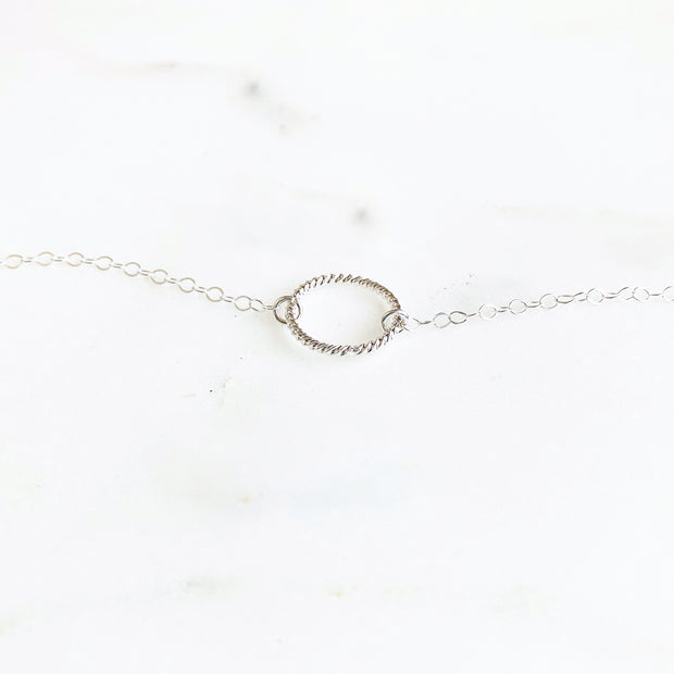 Simple Twisted Circle Charm Bracelet in Sterling Silver. Dainty Charm Bracelet