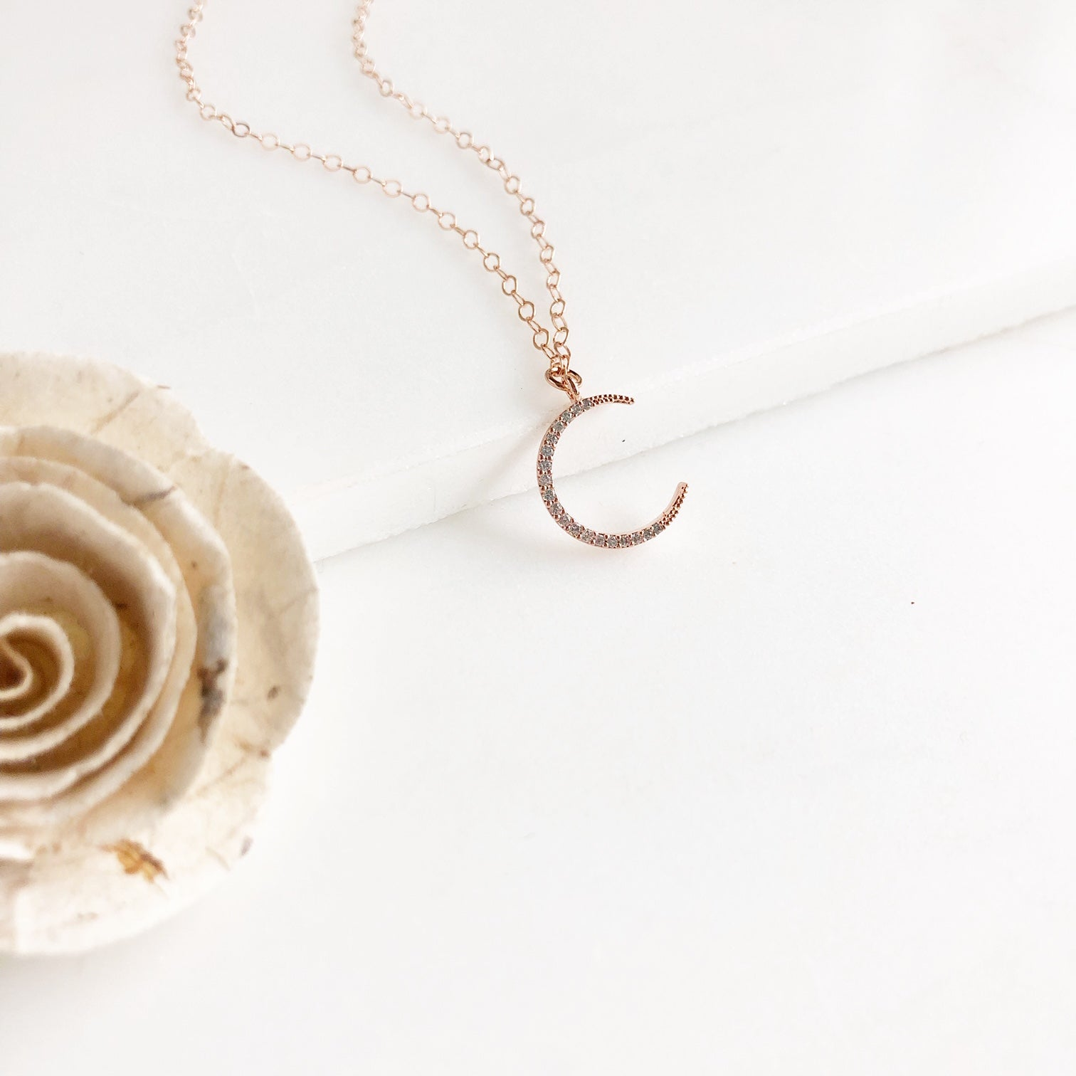 Rose Gold Cubic Zirconia Crescent Moon Necklace.
