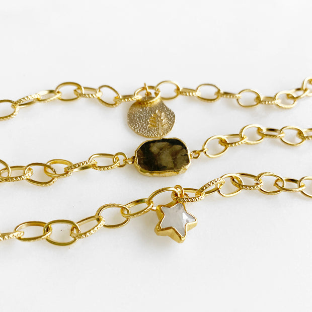 Set of Three Gold Chain Bracelets. Plant Leaf Charm Moonstone Star and Labradorite Stone Slice