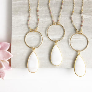 Long White Teardrop Pendant Necklace in Gold.