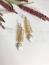 Load image into Gallery viewer, Unique White Arrow Dangle Earrings in Gold. Statement Earrings. Dangle Earrings. Chandelier Earrings. Fashion. Drop. Jewelry Christmas Gift