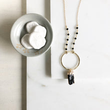 Load image into Gallery viewer, Black Raw Stone Necklace with Gold Circle and Black Beaded Chain. Long Black and Gold Necklace.