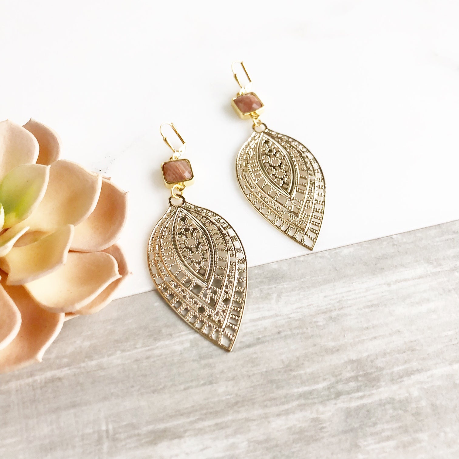 Large Leaf Earrings with Rust Red Orange Stones in Gold.