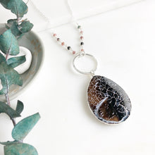 Load image into Gallery viewer, Long Earth Tone Crackle Teardrop and Ring Necklace in Silver with Beading Accents.