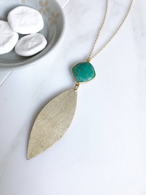 Long Turquoise Pendant Necklace in Gold. Long Bohemian Necklace with Teal Gemstone Pendant and Brushed Gold Marquise Pendant.