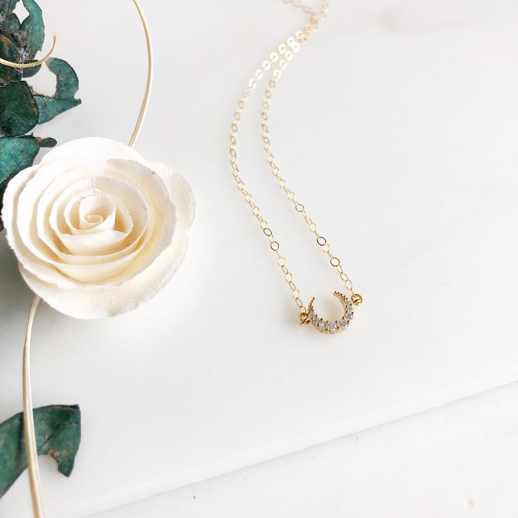 Cubic Zirconia Crescent Moon Necklace in Gold.
