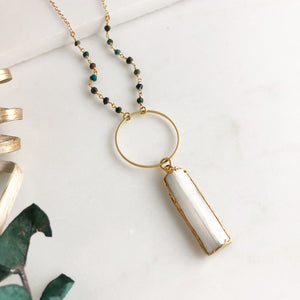 Long White Selenite and Circle Pendant Necklace with Green Beading in Gold.