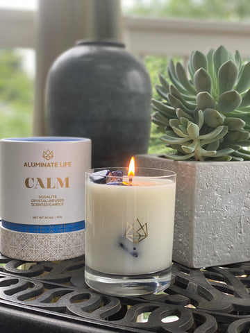 Calm candle with sodalite healing crystals