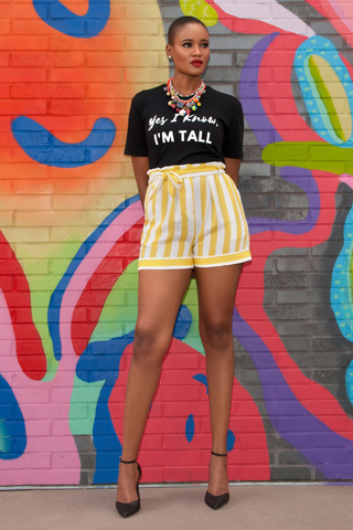HEIGHT GODDESS graphic tee styled with high waisted shorts