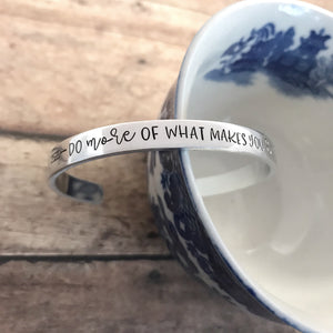 """Do more of what makes you happy"" cuff"