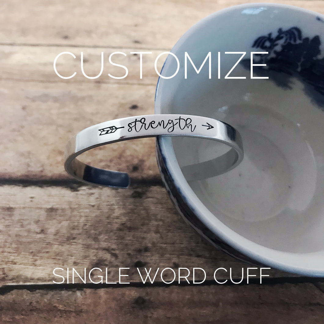 Single word arrow cuff