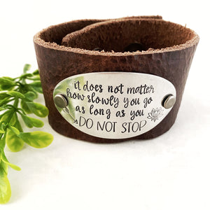 It does not matter how slowly you go leather cuff