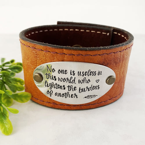 No one is useless in this world leather cuff