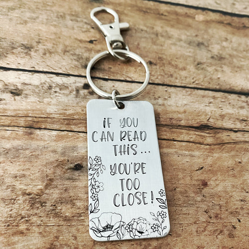 """If you can read this...you're too close"" keychain"