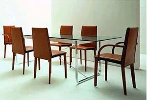 Italian dining table surrounded by leather chairs