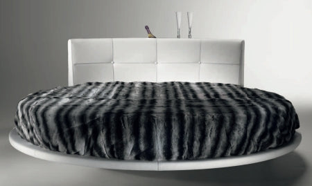 Head on view of Luxury modern  round bed  by Reflex made in Italy with Black and Gray Blanket