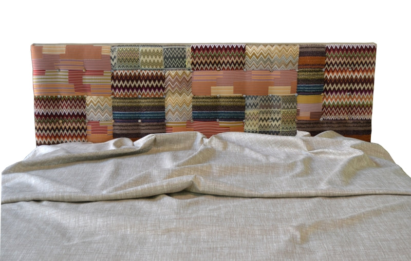 Italian bed with fabric patterned backboard
