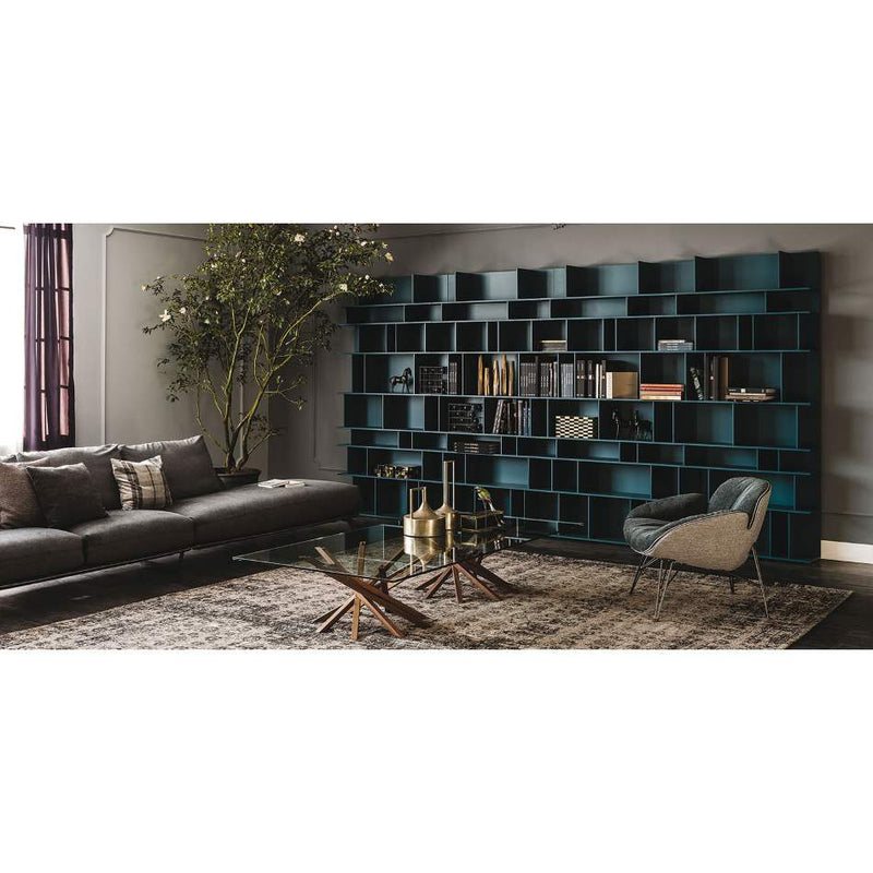 Luxury Italian bookcase with couch next to it